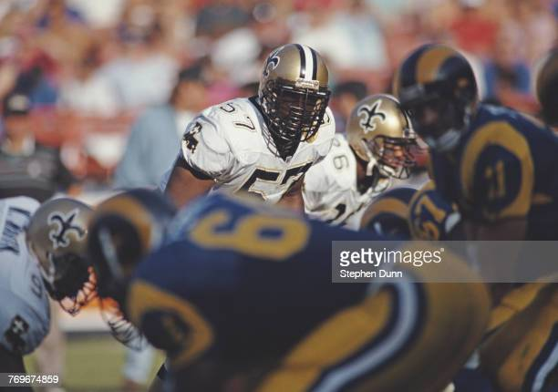 Rickey Jackson, Linebacker for the New Orleans Saints keeps his eyes on Jim Everett Quarterback for the Los Angeles Rams during their National...