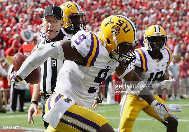 Rickey Jefferson of the LSU Tigers celebrates after intercepting a pass thrown by Bart Houston of the Wisconsin Badgers during the first half at...