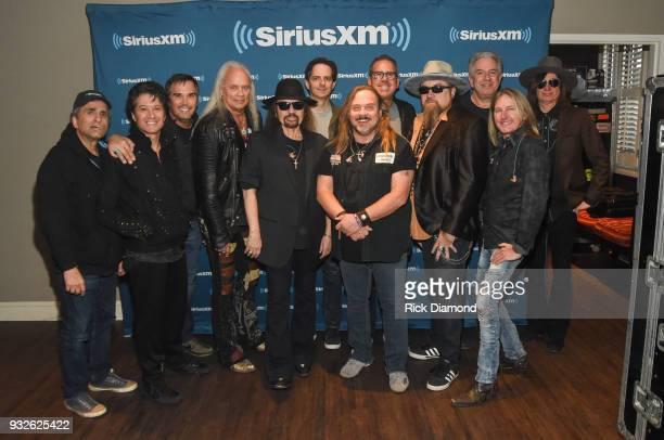 Rickey Medlocke Gary Rossington and Johnny Van Zant of Lynyrd Skynyrd pose with SiriusXM Vice President of Talent Relations Steve Leeds SiriusXM...