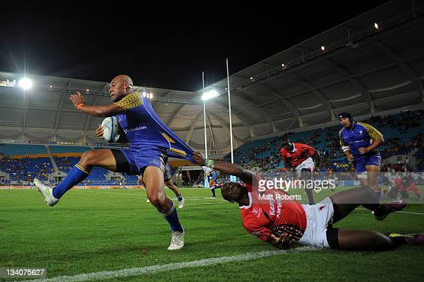 Ricki Helagi of Niue is tackled by Willy Ambaka Ndayara of Kenya during the match between Kenya and Niue on day one of the Gold Coast Sevens World...