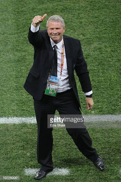 Ricki Herbert head coach of New Zealand celebrates holding Italy to a draw during the 2010 FIFA World Cup South Africa Group F match between Italy...