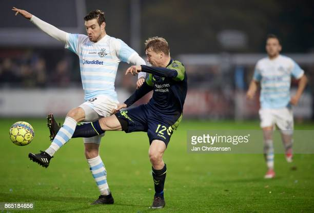 Ricki Olsen of FC Helsingor and Simon Tibbling of Brondby IF compete for the ball during the Danish Alka Superliga match between FC Helsingor and...