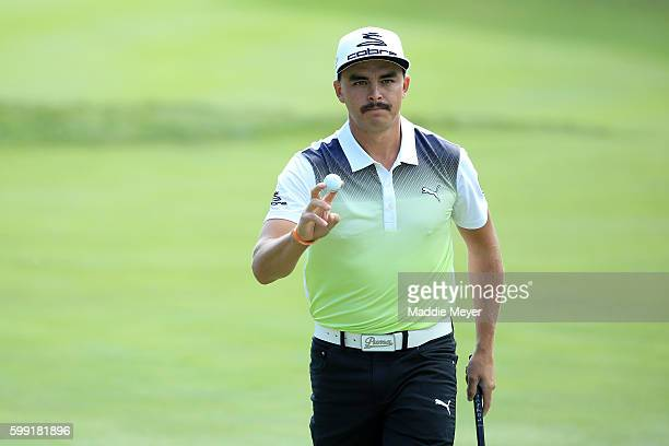 Rickie Fowler acknowledges the crowd on the ninth green during the third round of the Deutsche Bank Championship at TPC Boston on September 4 2016 in...
