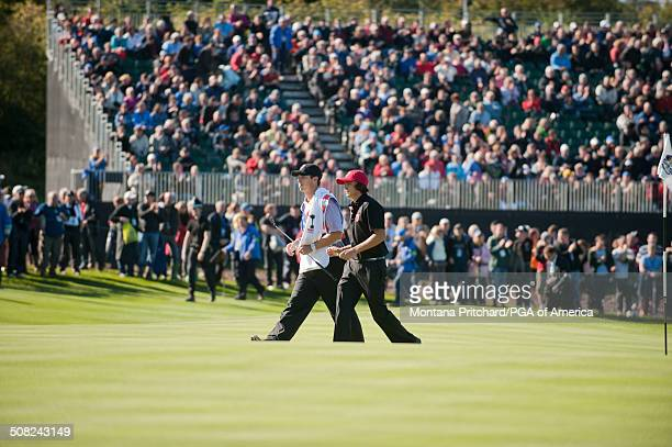 Rickie Fowler and caddie Joe Skovron during the session four singles matches at the 38th Ryder Cup at the Twenty Ten Course at Celtic Manor in...