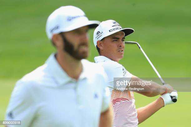 Rickie Fowler and Dustin Johnson of the United States stand on the eighth hole during round two of The Northern Trust at Glen Oaks Club on August 25...