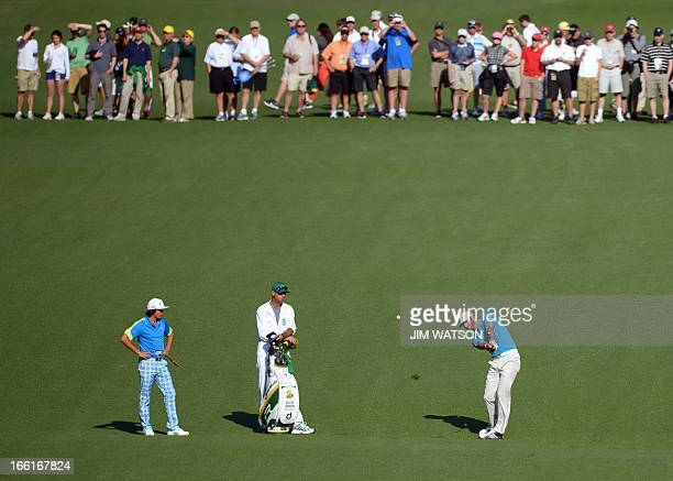 Rickie Fowler and Dustin Johnson of the US during a practice round at the 77th Masters golf tournament at Augusta National Golf Club on April 9 2013...