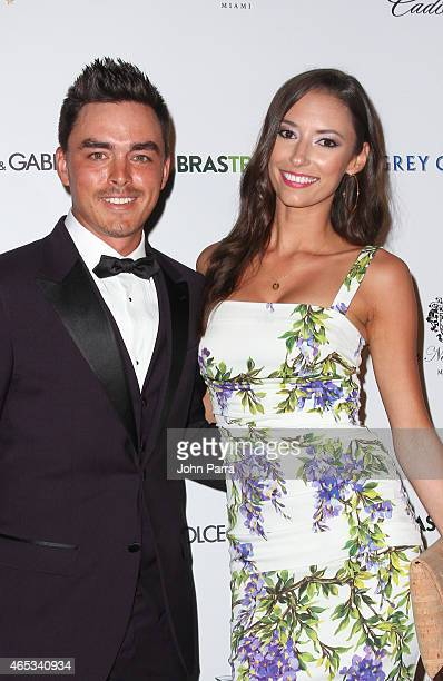 Rickie Fowler and guest arrive at the Dolce Gabbana Cadillac Championship Fashion Experience on March 5 2015 in Miami Florida
