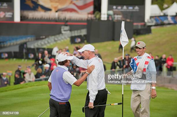 Rickie Fowler and Jim Furyk on the eighteenth hole during the foursome matches in session two at the 38th Ryder Cup at the Twenty Ten Course at...