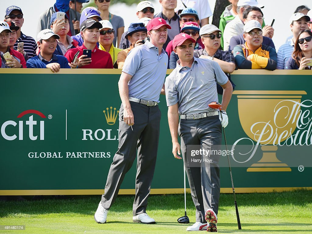Rickie Fowler and Jimmy Walker of the United States team react to a tee shot on the ninth hole prior to the start of The Presidents Cup at the Jack Nicklaus Golf Club on October 6, 2015 in Incheon City, South Korea.