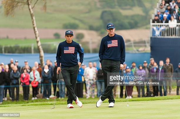 Rickie Fowler and Jimmy Walker of the United States wait to putt on four during the foursome matches for the 40th Ryder Cup at Gleneagles, on...
