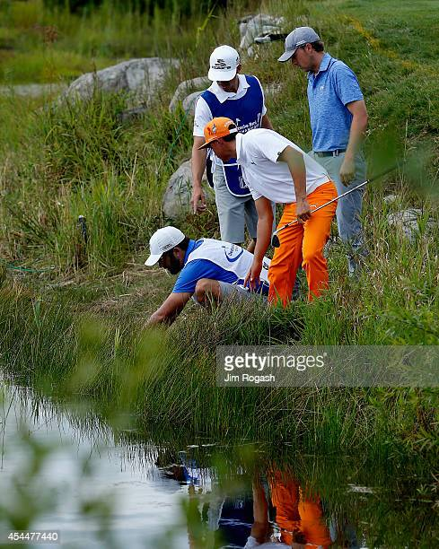 Rickie Fowler and Jordan Spieth look for their balls on the second hole during the final round of the Deutsche Bank Championship at the TPC Boston on...