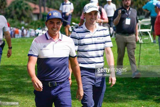 Rickie Fowler and Justin Thomas laugh together while walking off the second hole green during the first round of The Honda Classic at PGA National...