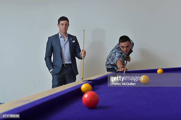 Rickie Fowler and Rory McIlroy play a game of pool on May 26, 2015 in Newcastle, Northern Ireland. The Rory Foundation are the hosts for a special...