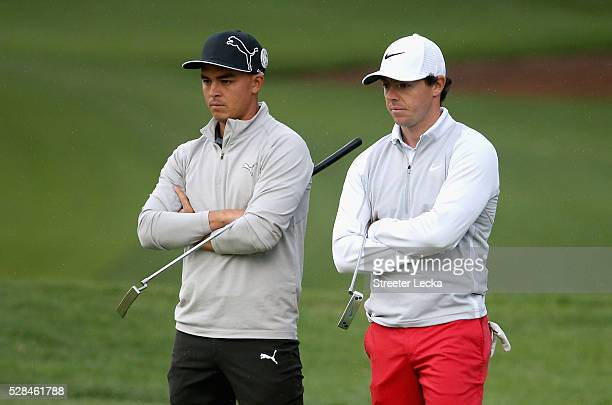 Rickie Fowler and Rory McIlroy wait on the 10th green during the first round of the 2016 Wells Fargo Championship at Quail Hollow Club on May 5 2016...