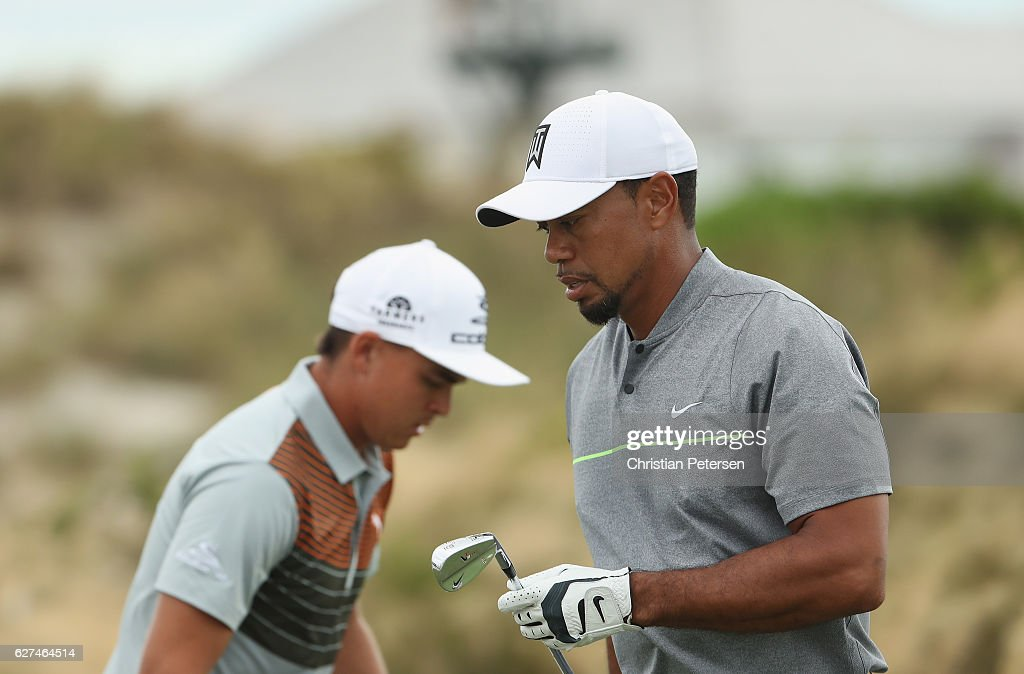 Rickie Fowler and Tiger Woods of the United States are seen on a green during round three of the Hero World Challenge at Albany, The Bahamas on December 3, 2016 in Nassau, Bahamas.