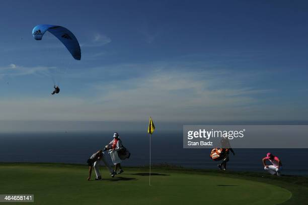 Rickie Fowler assesses a putt on the 4th green during the first round of the Farmers Insurance Open on Torrey Pines South on January 23, 2014 in La...