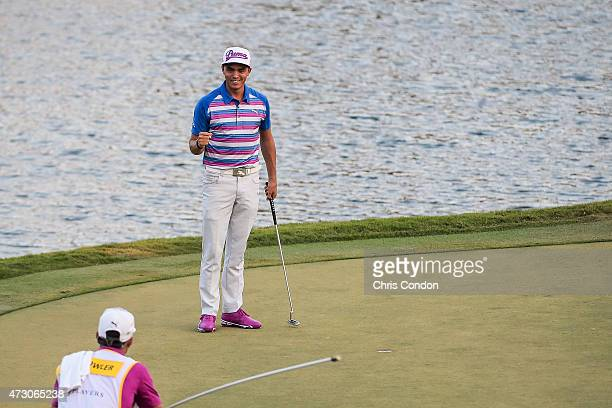 Rickie Fowler celebrates after making the winning birdie putt during a sudden death playoff on the 17th hole green in the final round of THE PLAYERS...