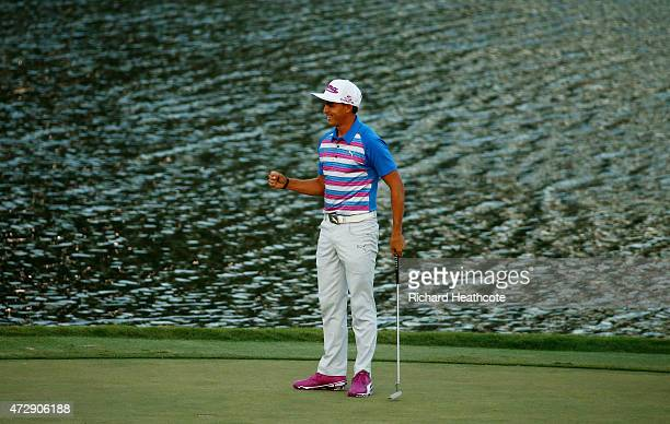 Rickie Fowler celebrates as he wins the playoff in the final round of THE PLAYERS Championship at the TPC Sawgrass Stadium course on May 10, 2015 in...