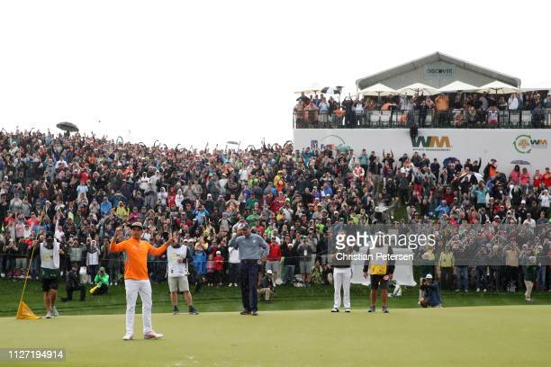 Rickie Fowler celebrates following his winning par putt on the 18th green during the final round of the Waste Management Phoenix Open at TPC...