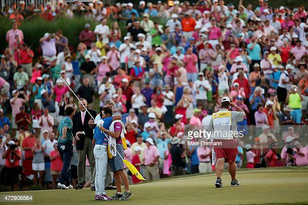 Rickie Fowler celebrates with caddie Joseph Skovron after winning the final round of THE PLAYERS Championship during a playoff at the TPC Sawgrass...
