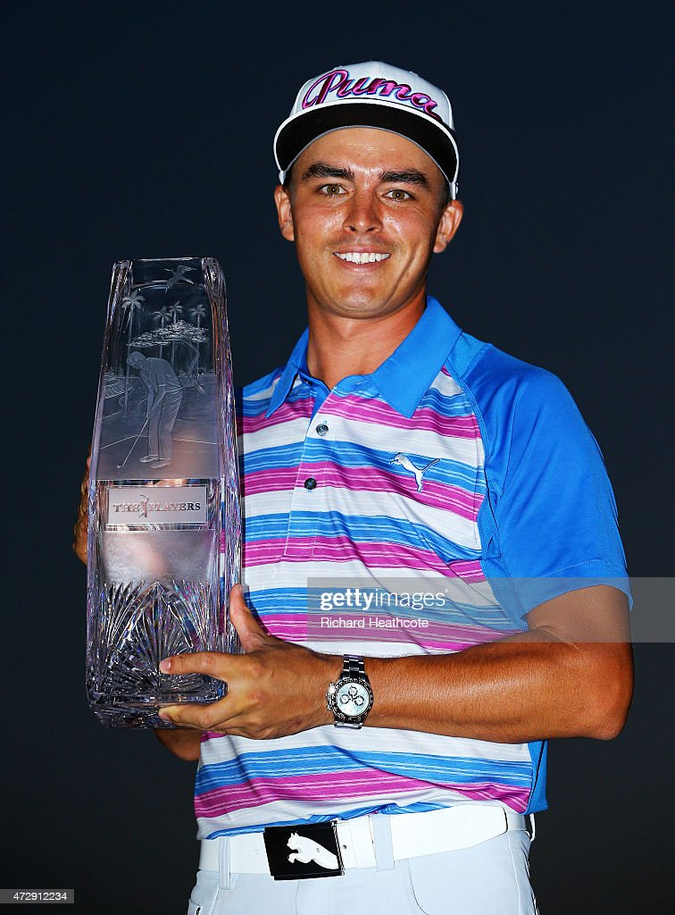 Rickie Fowler celebrates with the winner's trophy after the final round of THE PLAYERS Championship at the TPC Sawgrass Stadium course on May 10, 2015 in Ponte Vedra Beach, Florida.