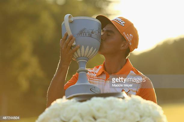 Rickie Fowler celebrates with the winners trophy after the final round of the Deutsche Bank Championship on September 7 2015 in Norton Massachusetts