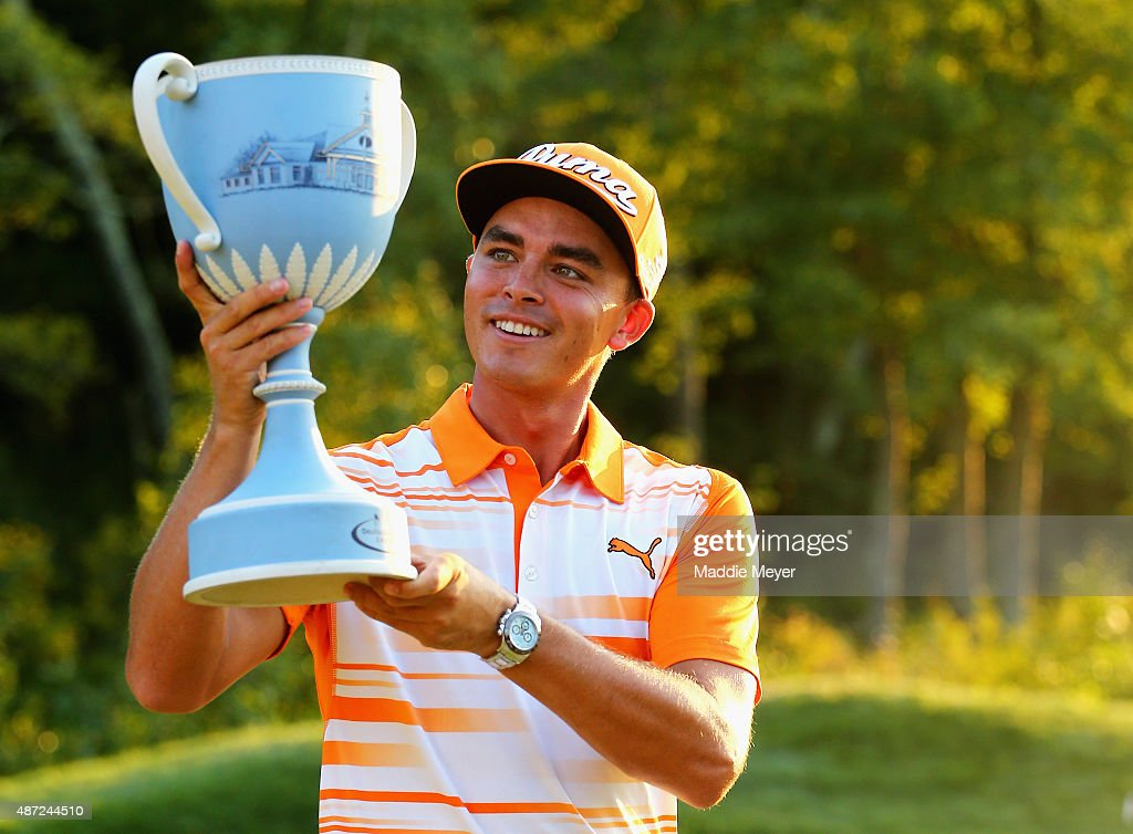 Rickie Fowler celebrates with the winners trophy after the final round of the Deutsche Bank Championship on September 7, 2015 in Norton, Massachusetts.