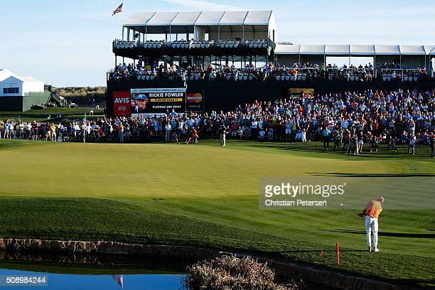 Rickie Fowler chips onto the green on the fourth playoff hole during the final round of the Waste Management Phoenix Open at TPC Scottsdale on...