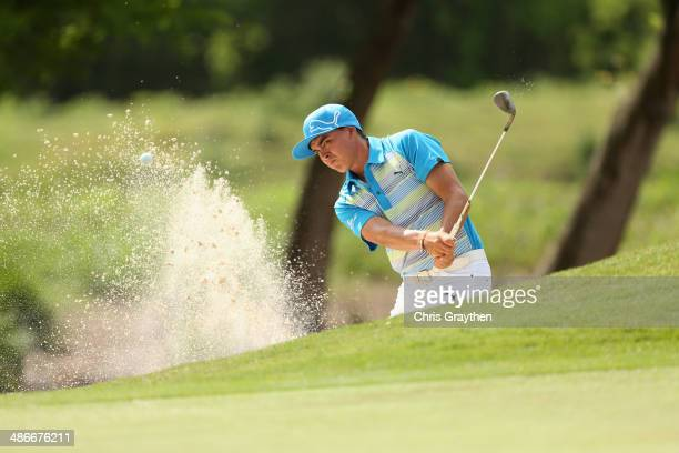 Rickie Fowler chips out of the bunker on the 2nd during Round Two of the Zurich Classic of New Orleans at TPC Louisiana on April 25, 2014 in...