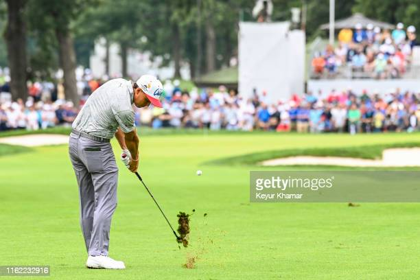 Rickie Fowler creates a divot as he plays his second shot on the 11th hole during the third round of the BMW Championship, the second event of the...