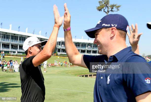 Rickie Fowler highfives Justin Thomas after making a hole in one on the 17th hole during the Dreams Come True Inside The Ropes Caddie Challenge...