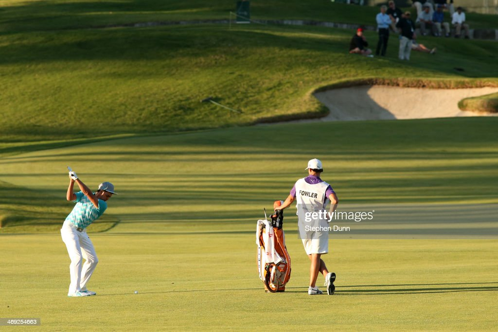 Rickie Fowler hits a fairway shot in the first round of the Northern Trust Open at the Riviera Country Club on February 13, 2014 in Pacific Palisades, California.