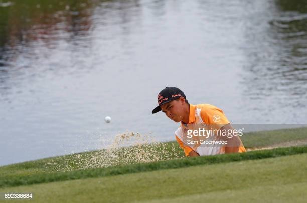 Rickie Fowler hits a shot from a bunker on the 13th hole during the final round of the Memorial Tournament at Muirfield Village Golf Club on June 4,...