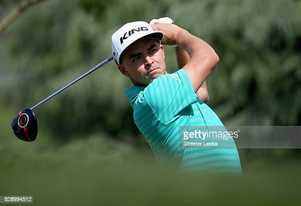 Rickie Fowler hits a tee shot on the 11th hole during the third round of the 2016 Wells Fargo Championship at Quail Hollow Club on May 7 2016 in...