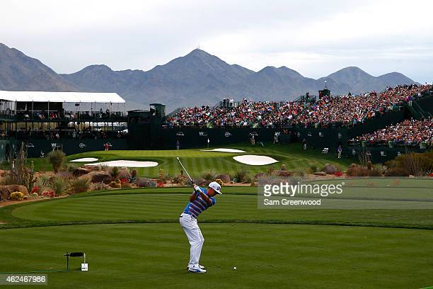 Rickie Fowler hits a tee shot on the 16th hole during the first round of the Waste Management Phoenix Open at TPC Scottsdale on January 29 2015 in...