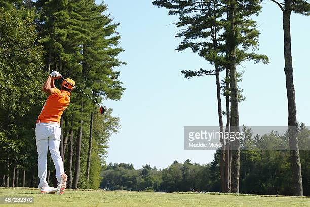 Rickie Fowler hits a tee shot on the sixth hole during the final round of the Deutsche Bank Championship at TPC Boston on September 7 2015 in Norton...