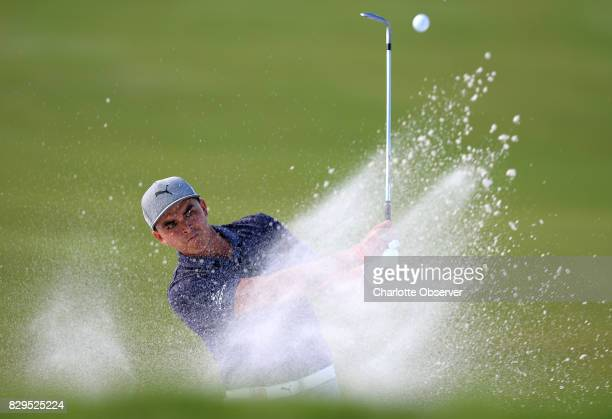 Rickie Fowler hits his ball from a sand trap along the 16th green during firstround action of the PGA Championship at Quail Hollow Club on Thursday...