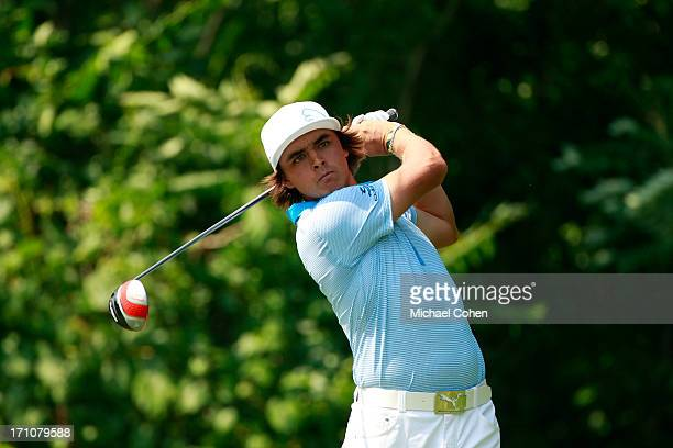 Rickie Fowler hits his drive on the 12th hole during the second round of the Travelers Championship held at TPC River Highlands on June 21 2013 in...