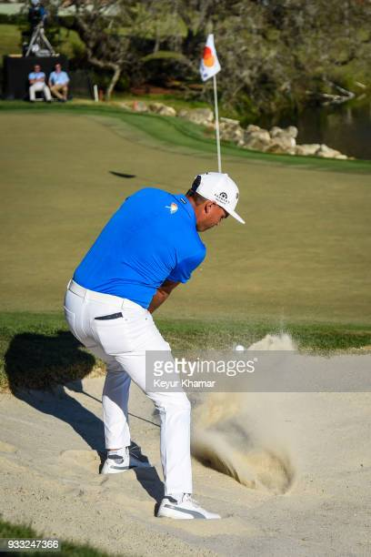 Rickie Fowler hits his fourth shot from a bunker on the 18th hole during the third round of the Arnold Palmer Invitational presented by MasterCard at...
