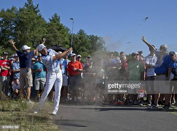 Rickie Fowler hits his second shot from behind the cart path on the 9th hole during the thirdround action at the Deutsche Bank Championship at TPC...