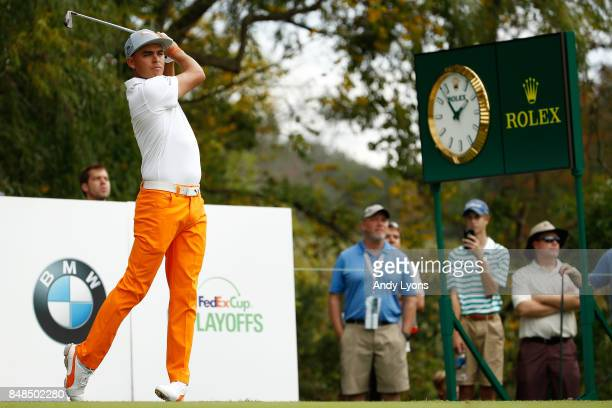 Rickie Fowler hits his tee shot on the sixth hole during the final round of the BMW Championship at Conway Farms Golf Club on September 17, 2017 in...
