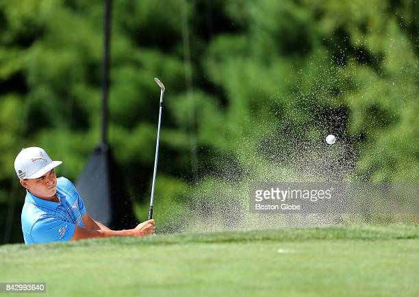 Rickie Fowler hits out of a sand trap on the 8th hole during the second round of the Dell Technologies Championship at the TPC Boston in Norton MA on...