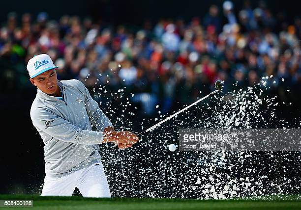 Rickie Fowler hits out of the bunker on the 16th hole during the first round of the Waste Management Phoenix Open at TPC Scottsdale on February 4...