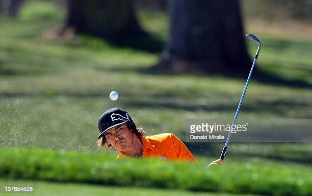 Rickie Fowler hits out of the bunker on the 17th hole during the third round of the Farmers Insurance Open at Torrey Pines Golf Course, North Course...