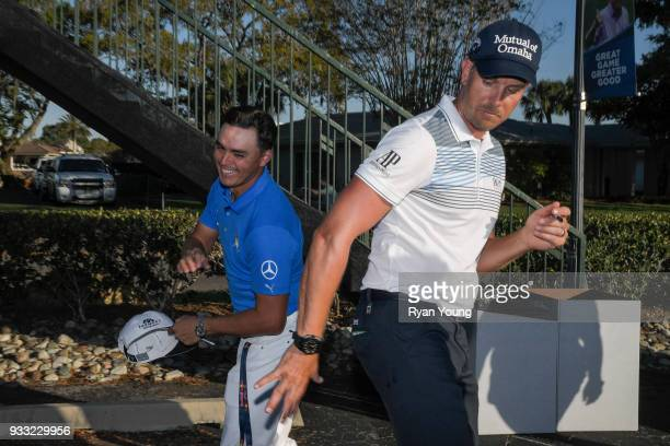 Rickie Fowler jokingly asks Henrik Stenson of Sweden for his autograph during the third round of the Arnold Palmer Invitational presented by...