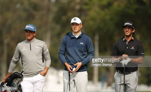 Rickie Fowler, Jordan Spieth and Max Homa of the United States wait together during a practice round prior to the 120th U.S. Open Championship on...