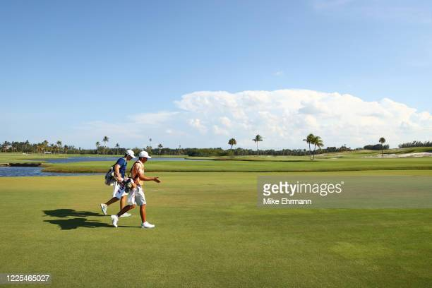 Rickie Fowler of the CDC Foundation team and Matthew Wolff of the CDC Foundation team walk during the TaylorMade Driving Relief Supported By...