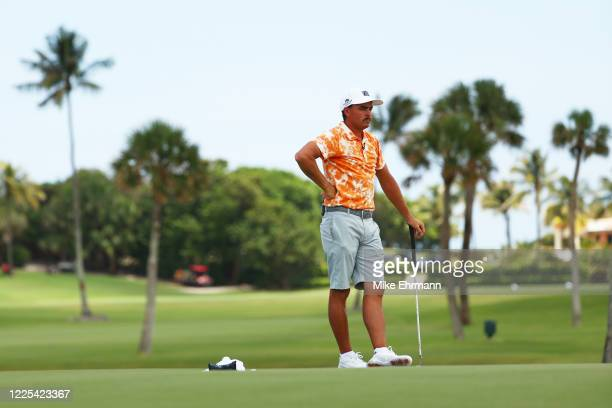 Rickie Fowler of the CDC Foundation team looks on over the first green during the TaylorMade Driving Relief Supported By UnitedHealth Group on May...