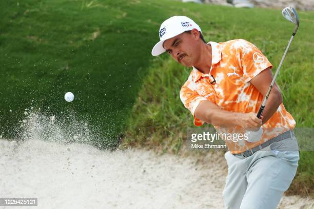 Rickie Fowler of the CDC Foundation team plays a shot from a bunker on the second hole during the TaylorMade Driving Relief Supported By UnitedHealth...