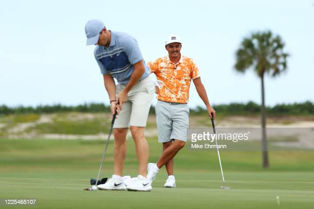 Rickie Fowler of the CDC Foundation team watches Rory McIlroy of the American Nurses Foundation team putt during the TaylorMade Driving Relief...